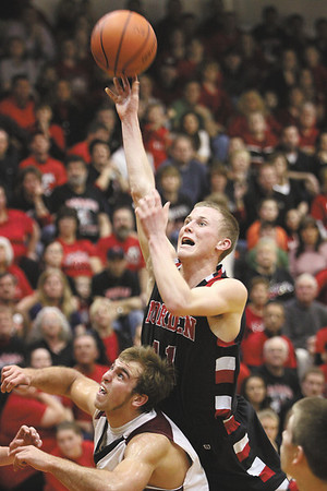 Borden junior Billy Kirchgessner scores over South Central in the Braves 71-51 1A sectional win Monday night.  Staff photo by C.E. Branham