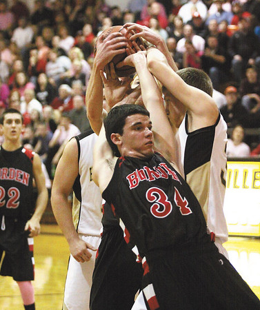 Borden junior Cody Bachman gets ties up in a rebound battle Saturday night at Henryville.  Staff photo by C.E. Branham