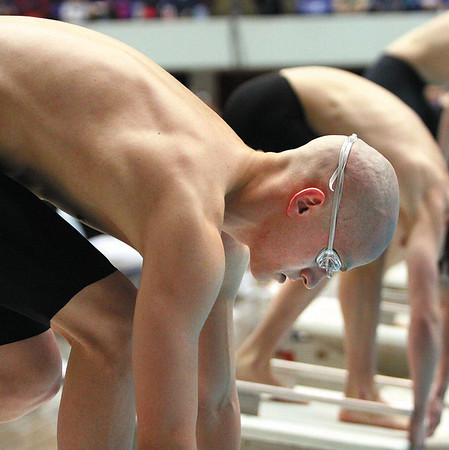 Jeff swimmer T. Martin steadies at the start of the 50 yard freestyle Saturday at the IHSAA Boys Swimming and Diving Championship.  Martin finished fourth in the 50 with a time of 21.04 and fourth in the 100 yard freestyle in 46.16.  Staff photo by C.E. Branham