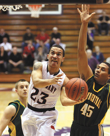 New Albany guard Jermaine Parrish gets past Floyd Central senior Jordan Thompson in the Bull Dogs 67-57 win Tuesday in 4A sectional play at Seymour.  Staff photo by C.E. Branham