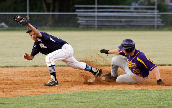 Providence High School sophomore Ben Shahroudi tags second base for an out during the sixth inning of their sectional championship game against Eastern Pekin High School at Providence on Saturday night. Providence lost the game 5-6. Staff photo by Christopher Fryer