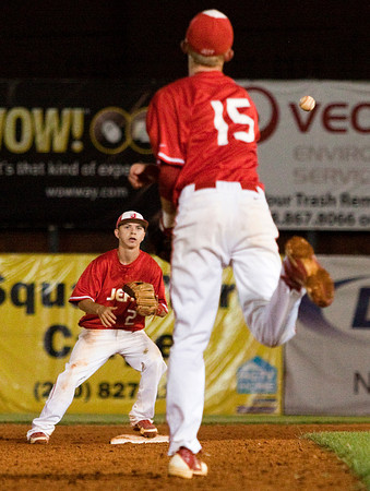 Jeffersonville High School third baseman Josh Burke throws to second baseman Dallas Bott for an out at second during the seventh inning of their game against New Palestine High School in the Indiana High School Athletic Association 4A Regional tournament at Bosse Field in Evansville on Saturday evening. New Palestine won the game 11-9. Staff photo by Christopher Fryer