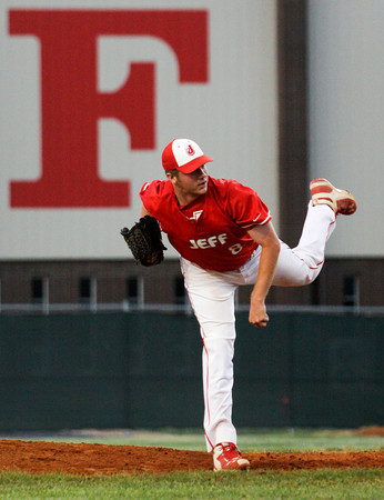 Jeffersonville High School junior Trent Astle pitches during the first inning of their game against Floyd Central High School at the Indiana High School Athletic Association Sectional tournament at Jeffersonville on Thursday evening. Staff photo by Christopher Fryer
