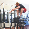 Uhl performs a series of seated box jumps, up to 40 inches, before doing squats at the YMCA.  Staff photo by C.E. Branham