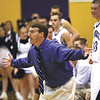 Providence coach Lou Lefevre expresses his feelings on an officials call Saturday at the 2A Paoli sectional.  The Pioneers advanced to the championship with a 64-52 win over Clarksville.  Staff photo by C.E. Branham