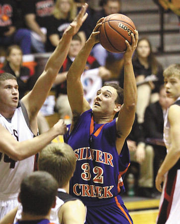 Jacob Brooks score for Silver Creek in a 52-50 3A sectional loss to Brownstown Central Wednesday night at Salem.  Staff photo by C.E. Branham