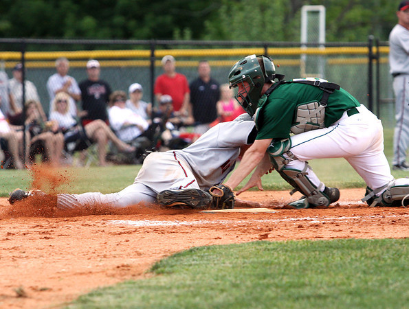 Floyd Central catcher Tanner Wortham tags out New Albany player Cameron Mullins Monday evening in Hoosier Hills Conference tourney play. Staff photo by C.E. Branham
