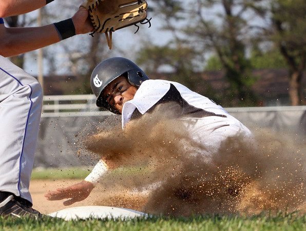 Nathaniel Jones steals third for the Clarksville Generals in their game against Charlestown on Thursday. Staff photo by C.E. Branham