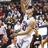 Silver Creek guard Grant Meyer lays in a reverse for a bucket Friday night against undefeated Brownstown.  The Dragons beat the 3A no. 5 Braves 72-63.  Staff photo by C.E. Branham