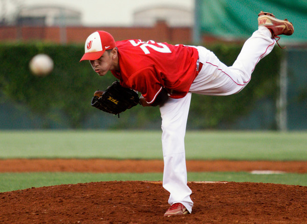 Jeffersonville High School junior Nick Gallagher pitches during the second inning of their game against New Palestine High School in the Indiana High School Athletic Association 4A Regional tournament at Bosse Field in Evansville on Saturday evening. New Palestine won the game 11-9. Staff photo by Christopher Fryer