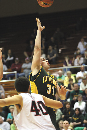 Floyd Central senior Connor Schellenberg puts up a runner  n a 67-57 loss to New Albany in the opening game of the 4A sectional at Seymour.  Staff photo by C.E. Branham