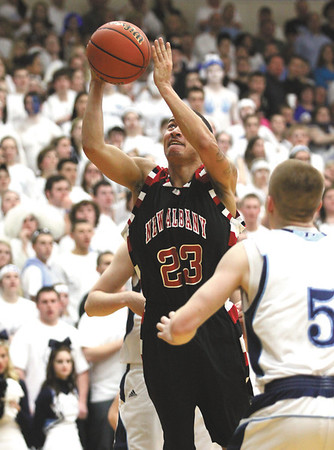 New Albany guard Jermaine Parrish scored the Bulldogs only field goal in the first half on this drive.  Staff photo by C.E. Branham