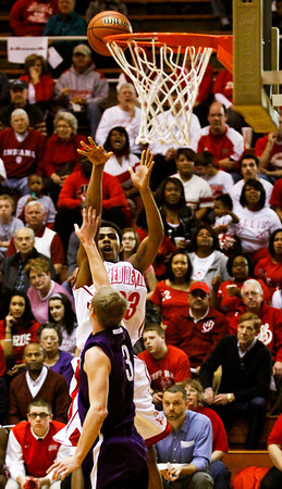 Jeffersonville guard Darryl Baker rises up for a shot over Bloomington South forward Michael Bower during their game in the 4A regional tournament at Shelbyville High School on Saturday afternoon. Bloomington South won the game 35-34. Staff photo by Christopher Fryer