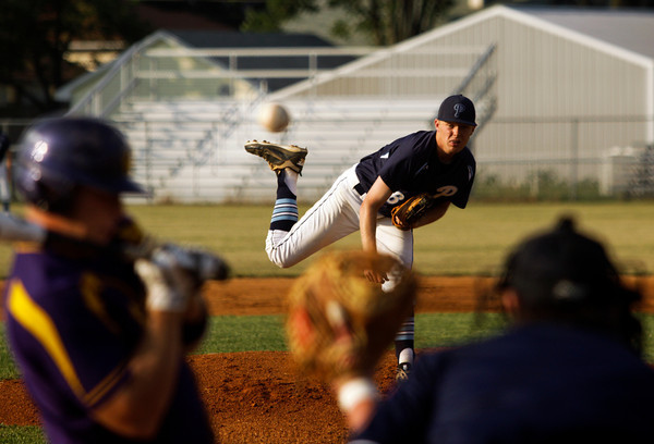 Providence High School senior Brenden Popson pitches during the first inning of their sectional championship game against Eastern Pekin High School at Providence on Saturday night. Providence lost the game 5-6. Staff photo by Christopher Fryer