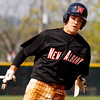 New Albany's Tucker Marcum rounds third base on his way to score during the fourth inning of their game against South Dearborn High School in New Albany on Saturday afternoon. The Bulldogs won the game 11-1. Staff photo by Christopher Fryer
