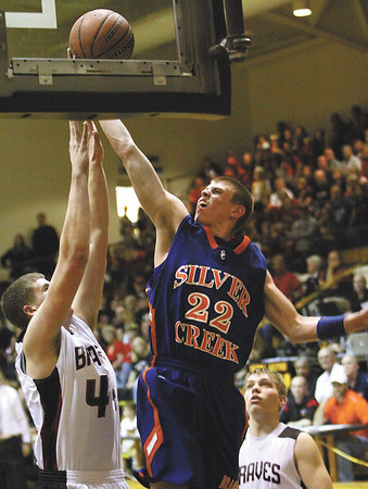 Silver Creek guard Caleb Sprigler scores in the fourth quarter against Brownstown Central Wednesday night.  The Dragons fell to the Braves 52-50 in their opening 3A sectional game.  Staff photo by C.E. Branham