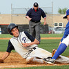 Providence runner Jacob Quinkert is out on an attempt to steal third after the tag by Silver Creek third baseman Lucas Barnett. Staff photo by C.E. Branham