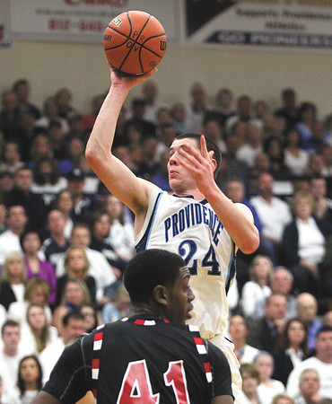 Providence junior center George Knott shoots a floater in the lane to score on New Albany Friday night at Providence.  Staff photo by C.E. Branham