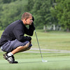 New Albany No. 1 golfer studies his putt on his third hole of the Southern Indiana Open on Saturday at Hidden Creek Golf Club. Staff photo by C.E. Branham