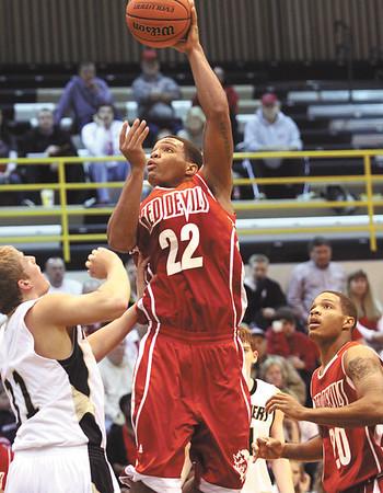 Jeffersonville senior Jordan Ellis puts up a shot in the lane on Corydon Central Tuesday night.  Staff photo by C.E. Branham