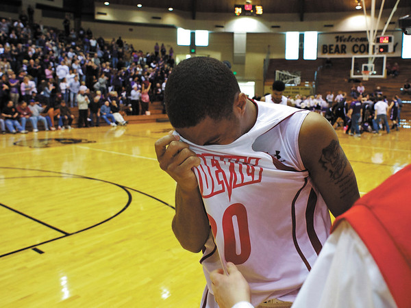 Jeffersonville guard Jonathan Ellis wipes away tears after his team lost to Bloomington South in the 4A regional tournament at Shelbyville High School on Saturday afternoon. The final score was 35-34. Staff photo by Christopher Fryer