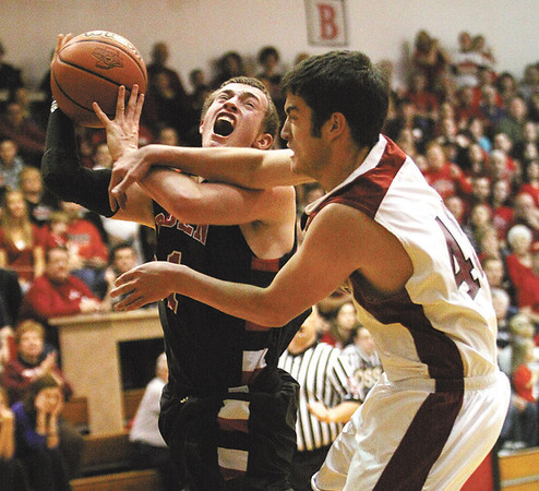 Borden guard Garrett Vick is fouled hard by South Central defender Sam Cunningham.  Staff photo by C.E. Branham