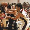 Borden guard Garrett Vick is fouled hard by South Central defender Sam Cunningham.  Staff photo by C.E. Branham