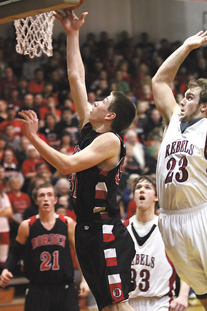 Borden junior Michael Lynch lays in two in the Braves 71-51 1A sectional win over South Central Monday night.  Staff photo by C.E. Branham