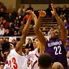From left,  Jeffersonville guards Darryl Baker and Bryce Roland rise up against Bloomington South guard Jonathan Winters during their game in the 4A regional tournament at Shelbyville High School on Saturday afternoon. Bloomington South won the game 35-34. Staff photo by Christopher Fryer