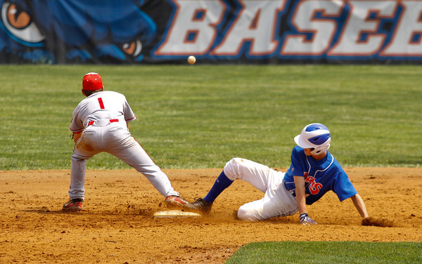 Silver Creek High School outfielder Brooks Howell slides safely into second base past Madison High School shortstop Aaron Smith during the third inning of Game 1 of a doubleheader at Silver Creek on Saturday afternoon. Madison won the game, 11-10. Staff photo by Christopher Fryer