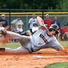 Clayton Poff slides home to score for New Albany in a game against Floyd Central to open the Hoosier Hills Conference tournament. Staff photo by C.E. Branham