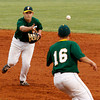 Floyd Central High School first baseman Ross Lundy tosses the ball to pitcher Cody Sunderhaus for an out at first base during their home game against Providence High School on Friday night. Floyd Central won the game 9 to 3. Staff photo by Christopher Fryer