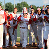 Jeffersonville High School players wait for teammate Isaac Crafton to reach home after Crafton hit a homer to beat New Albany 1-0 in the bottom of the eight inning in the Hoosier Hills Conference Tournament semi-final. Staff photo by C.E. Branham