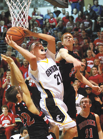 Clarksville guard Aidan McEwen gets to the basket between a couple Borden defenders Friday night at Clarksville.  Staff photo by C.E. Branham
