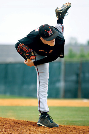 New Albany pitcher Josh Rogers deals from the mound Saturday afternoon against North Harrison in the final game of the Stan Sajko Invitational at Mount Tabor Park. Staff photo by Kevin McGloshen