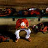 Jeffersonville High School junior Nick Gallagher holds his head in his hands in the dugout after their 11-9 loss to New Palestine High School in the Indiana High School Athletic Association 4A Regional tournament at Bosse Field in Evansville on Saturday evening. Staff photo by Christopher Fryer