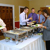 Guests to the Johnny Wilson Awards luncheon enjoy the buffet.