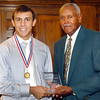 2012 Johhny Wilson Award winner Johnny Slivka of Shenandoah High School receives his award from Johnny Wilson.