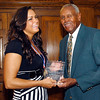 2012 Johhny Wilson Award winner Olivia Stroup of Madison-Grant High School receives her award from Johnny Wilson.