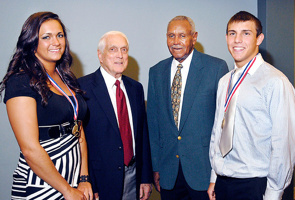 the 2012 Johnny Wilson Award winners Olivia Stroup, left, of Madison-Grant high School, and Johnny Slivka, right, of Shenandoah High School, pose with Carl Erskine and Johnny Wilson.