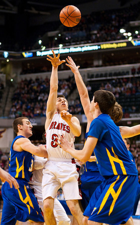 Borden forward Michael Lynch goes up for a shot during their game against Triton for the Class A state championship at Bankers Life Fieldhouse in Indianapolis on Saturday. The Braves won the game, 55-50. Staff photo by Christopher Fryer