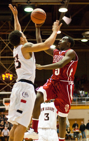 Jeffersonville senior Jacquari Chandler goes up for a shot during their game against New Albany in the final round of the Seymour Sectional on Saturday. Jeffersonville won the game,  63-50. Staff photo by Christopher Fryer