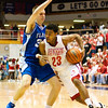 Jeffersonville senior Darryl Baker drives to the basket during their game against Franklin Central in the final round of the regional tournament at Seymour on Saturday. Jeffersonville won the game, 85-69. Staff photo by Christopher Fryer