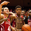 Jeffersonville poses for photographs with their sectional championship trophy after defeating New Albany 63-50 in Seymour on Saturday. Staff photo by Christopher Fryer