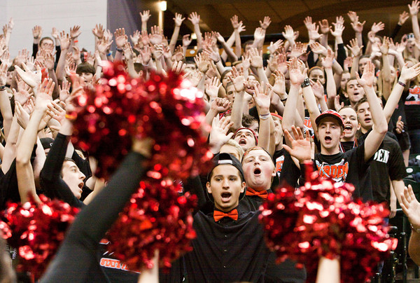 Borden fans cheer as they watch their team take on Triton for the Class A state championship at Bankers Life Fieldhouse in Indianapolis on Saturday. The Braves won the game, 55-50. Staff photo by Christopher Fryer