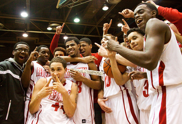 Jeffersonville players pose for photographs after defeating Franklin Central 85-69 in the championship game of the regional tournament at Seymour on Saturday. Staff photo by Christopher Fryer