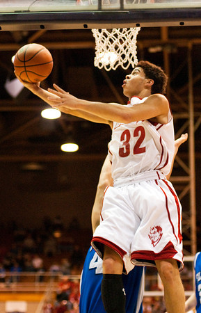 Jeffersonville junior Keenan Williams goes up for a shot during their game against Franklin Central in the final round of the regional tournament at Seymour on Saturday. Jeffersonville won the game, 85-69. Staff photo by Christopher Fryer