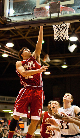 Jeffersonville junior Keenan Williams goes up for a shot during their game against New Albany in the final round of the Seymour Sectional on Saturday. Jeffersonville won the game,  63-50. Staff photo by Christopher Fryer