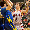 Borden guard Josh Vollstedt covers Triton guard Joey Corder during their Class A state championship game at Bankers Life Fieldhouse in Indianapolis on Saturday. The Braves won the game, 55-50. Staff photo by Christopher Fryer