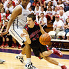 Borden senior Jalen McCoy drives to the basket during their game against University in the semi-state tournament at Seymour on Saturday. Borden won the game, 47-44. The Braves will face Triton for the Class A state championship in Indianapolis on Saturday March 23. Staff photo by Christopher Fryer